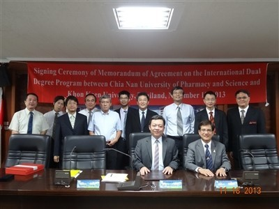 Group photo of participants in the signing ceremony