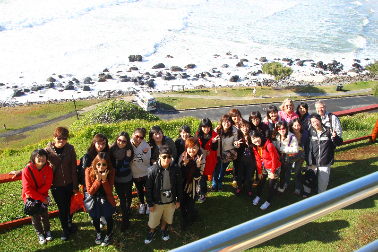 Students on the CNU 2012 Australian Situational Learning Camp pause for a group photo at the Point Danger lookout, at Tweed Heads, New South Wales.