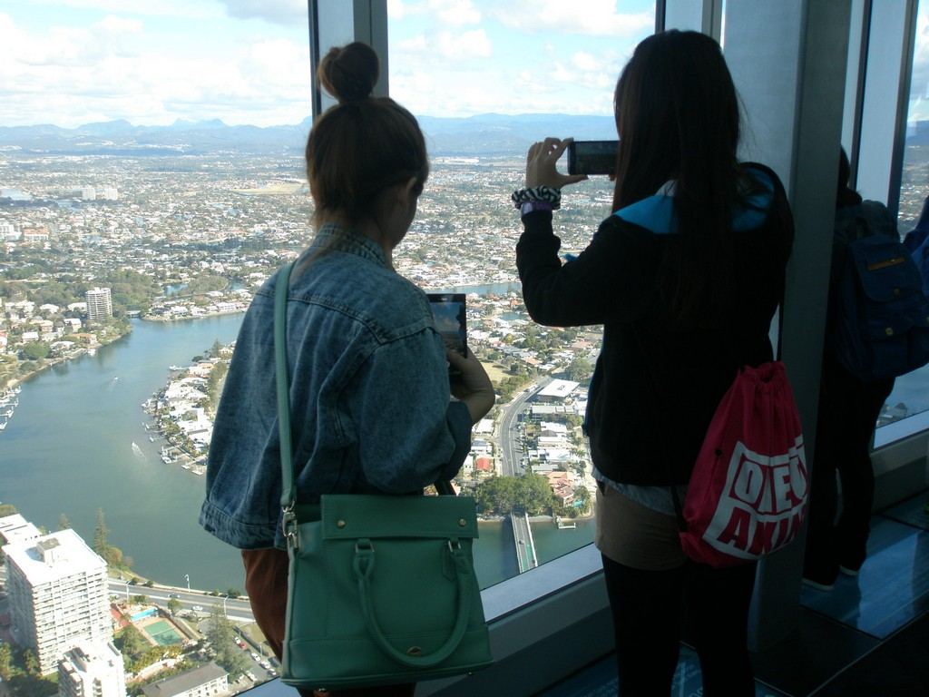 Students Alyssa Lin and Karol Lin (Department of Applied Foreign Language) enjoy a view of the Gold Coast from the Q1 Observation Deck
