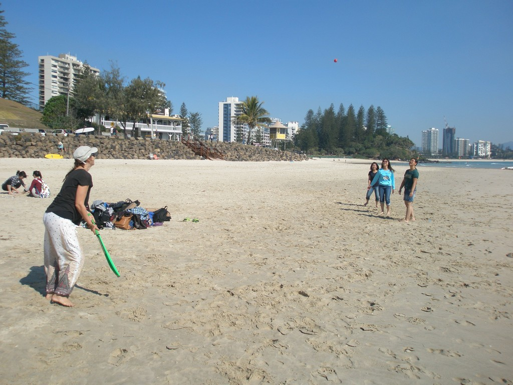 A game of beach cricket with teacher Rose