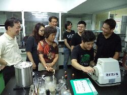 Professor Huang Hsiu-Chin guides students in the use of a rolling slicer