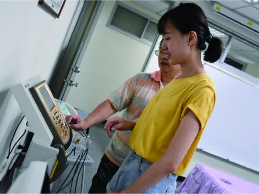 Teacher teaching student to use smart health device