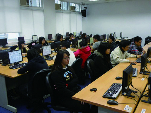 Students learning in computer class