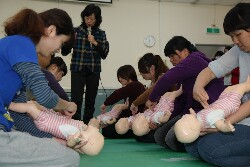 A class in emergency first aid for infants in the Department of Childhood Education and Nursery