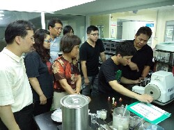 An industry specialist showing graduate students how to use instruments