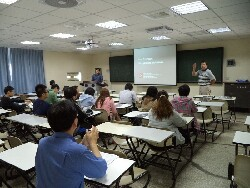 An industry specialist co-teaching a Pharmacy class