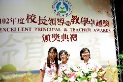CNU Affiliated Tainan City Preschool is presented with a silver medal in the Ministry of Education's 2013 Teaching Excellence Awards