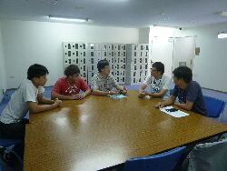A teacher visits students on a summer internship at the Tainan plant of Toppan Ltd.
