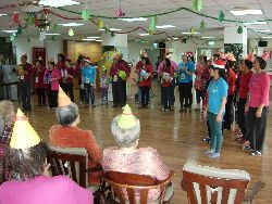 Students and staff lead a Christmas party at Rijian Elderly Care Center