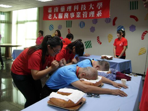 Students participating in a massage service activity for the elderly
